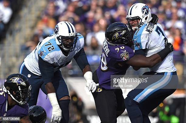 Quarterback Zach Mettenberger of the Tennessee Titans is sacked by outside linebacker Elvis Dumervil of the Baltimore Ravens in the second quarter of...