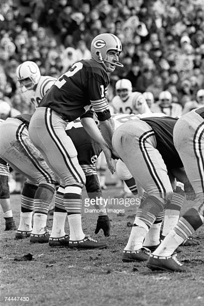 Quarterback Zeke Bratkowski of the Green Bay Packers calls out the signals at the line of scrimmage during a game in the late 1960's against the...