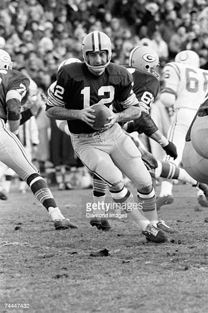 Quarterback Zeke Bratkowski of the Green Bay Packers drops back to pass during a game in the late 1960's against the Baltimore Colts at Memorial...