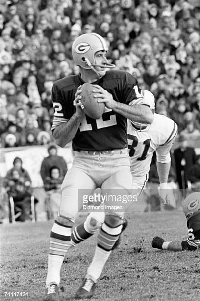 Quarterback Zeke Bratkowski of the Green Bay Packers sets up to pass the ball during a game in the late 1960's against the Baltimore Colts at...