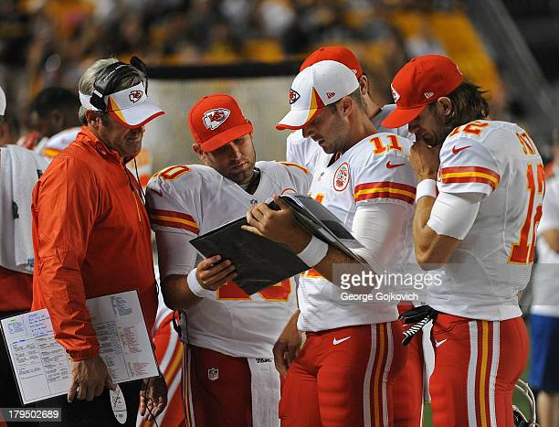 Quarterbacks Alex Smith Chase Daniel and Ricky Stanzi of the Kansas City Chiefs confer with offensive coordinator Doug Pederson during a preseason...