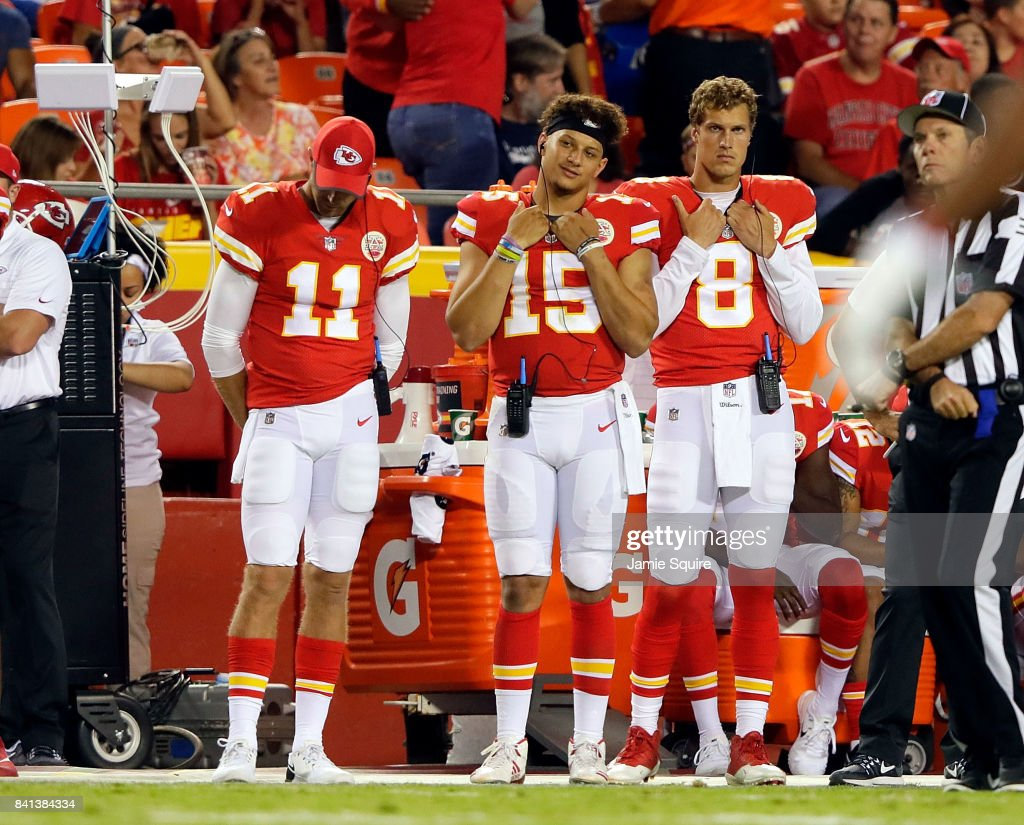 Quarterbacks Alex Smith #11, Patrick Mahomes #15, and Joel Stave #8 watch from the sidelines during the game against the Tennessee Titans at Arrowhead Stadium on August 31, 2017 in Kansas City, Missouri.