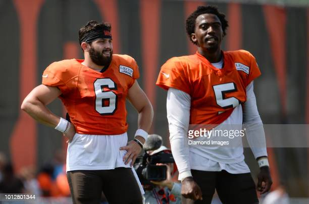 Quarterbacks Baker Mayfield and Tyrod Taylor of the Cleveland Browns stand on the field during a training camp practice on July 28 2018 at the...