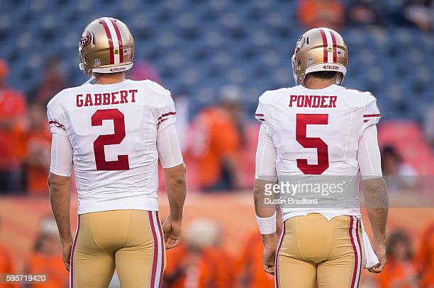 Quarterbacks Blaine Gabbert and Christian Ponder of the San Francisco 49ers stand on the field before a preseason NFL game against the Denver Broncos...