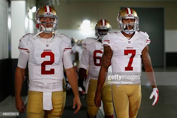 Quarterbacks Blaine Gabbert and Colin Kaepernick take the field prior to the NFL game against the Arizona Cardinals at the University of Phoenix...