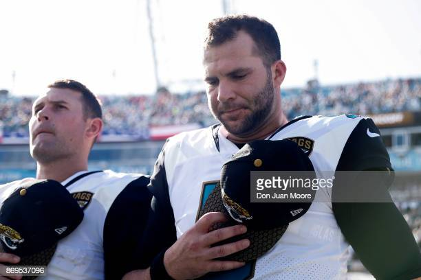 Quarterbacks Blake Bortles and Chad Henne of the Jacksonville Jaguars during the National Anthem before the game against the Los Angeles Rams at...