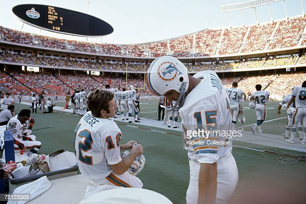Quarterbacks Bob Griese and Earl Morrall of the Miami Dolphins on the bench during the fourth quarter of a game on September 17 1972 against the...