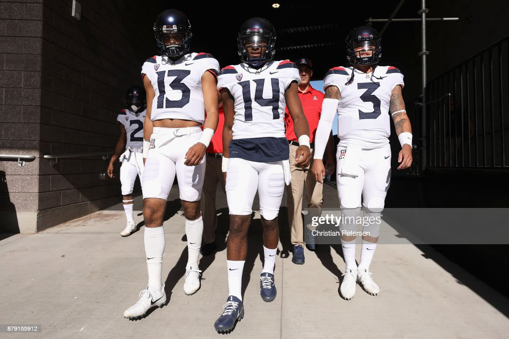 Quarterbacks Brandon Dawkins #13, Khalil Tate #14 and Donovan Tate #3 of the Arizona Wildcats walk out onto the field before the college football game against the Arizona State Sun Devils at Sun Devil Stadium on November 25, 2017 in Tempe, Arizona.