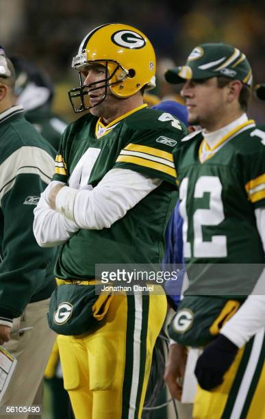 Quarterbacks Brett Favre and Aaron Rodgers of the Green Bay Packers watch the final minutes of a game against the Pittsburgh Steelers from the...
