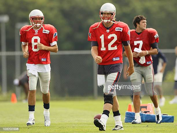 Quarterbacks Brian HoyerTom Brady and Zac Robinson of the New England Patriots head to their next drill during training camp on August 2 2010 at...