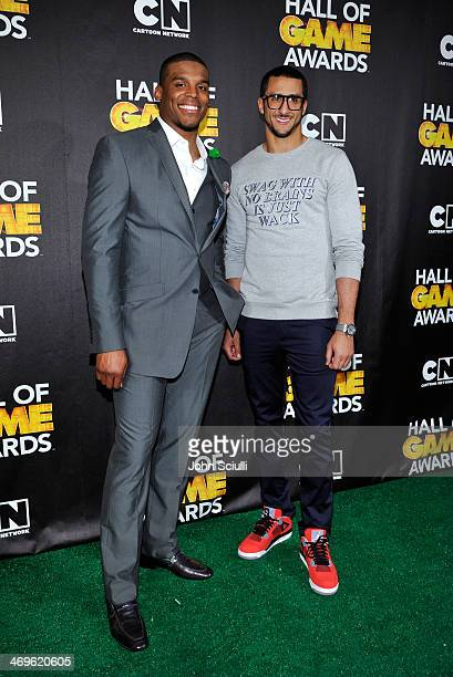 Quarterbacks Cam Newton of the Carolina Panthers and Colin Kaepernick of the San Francisco 49ers poses in the press room during Cartoon Network's...