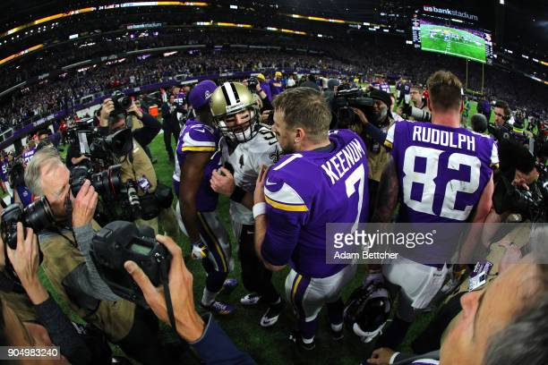 Quarterbacks Case Keenum of the Minnesota Vikings and Drew Brees of the New Orleans Saints greet each other after the NFC Divisional Playoff game on...