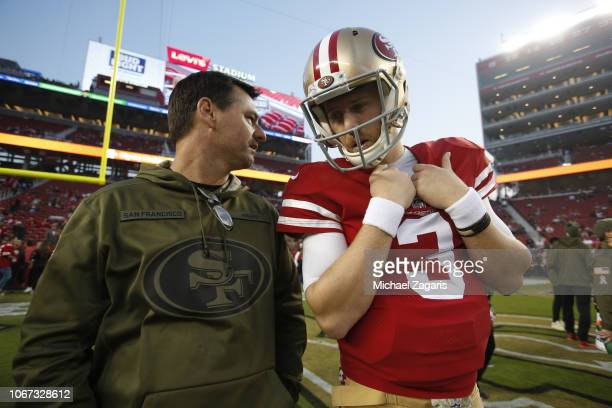 Quarterbacks Coach Rich Scangarello and CJ Beathard of the San Francisco 49ers talk on the field prior to the game against the New York Giants at...
