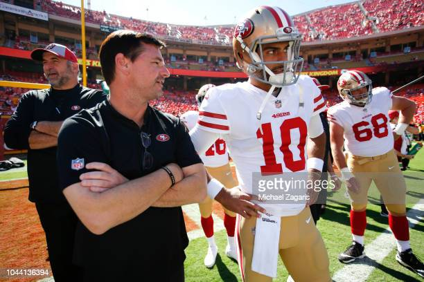 Quarterbacks Coach Rich Scangarello and Jimmy Garoppolo of the San Francisco 49ers stands on the field prior to the game against the Kansas City...