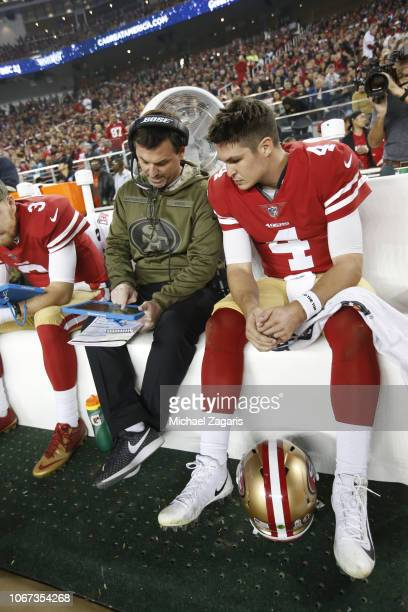 Quarterbacks Coach Rich Scangarello and Nick Mullens of the San Francisco 49ers talk on the sideline during the game against the New York Giants at...
