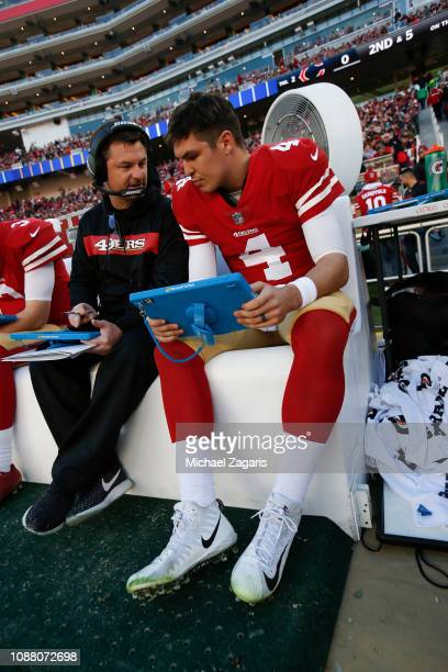 Quarterbacks Coach Rich Scangarello and Nick Mullens of the San Francisco 49ers talk on the sideline during the game against the Chicago Bears at...