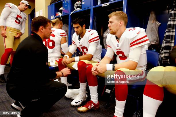 Quarterbacks Coach Rich Scangarello of the San Francisco 49ers talks with Jimmy Garoppolo and CJ Beathard in the locker room prior to the game...