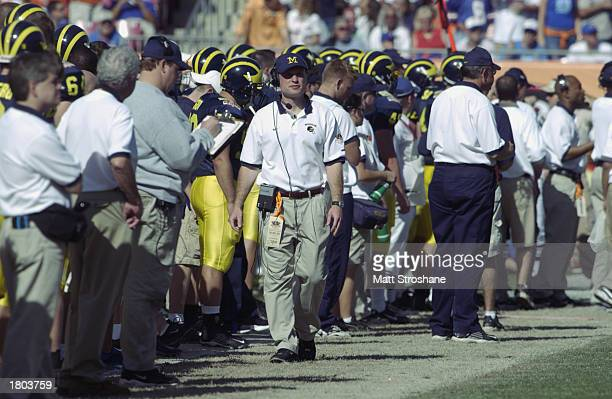 Quarterbacks coach Scot Loeffler of the Michigan Wolverines walks on the sidelines during the game against the Florida Gators in the Outback Bowl at...