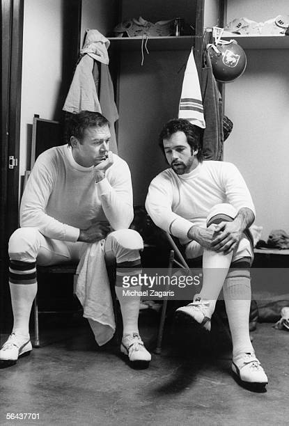 Quarterbacks Craig Morton and Matt Robinson of the Denver Broncos talk in the locker room before the game against the Oakland Raiders at the Oakland...