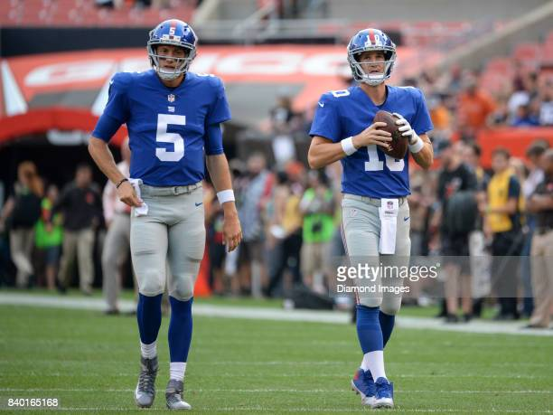 Quarterbacks Davis Webb and Eli Manning of the New York Giants walk onto the field prior to a preseason game on April 27 2017 against the Cleveland...