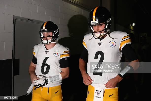 Quarterbacks Devlin Hodges and Mason Rudolph of the Pittsburgh Steelers walk out onto the field before the NFL game against the Arizona Cardinals at...