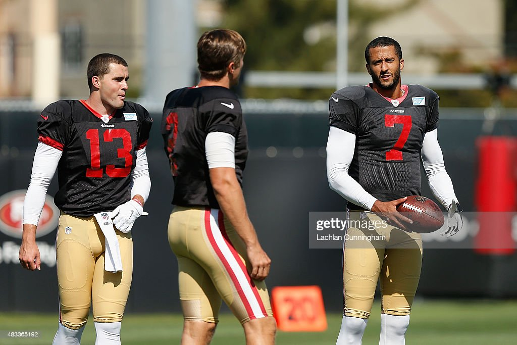 Quarterbacks Dylan Thompson #13, Blaine Gabbert #2 and Colin Kaepernick #7 of the San Francisco 49ers talk between drills during a practice session at Levi's Stadium on August 7, 2015 in Santa Clara, California.