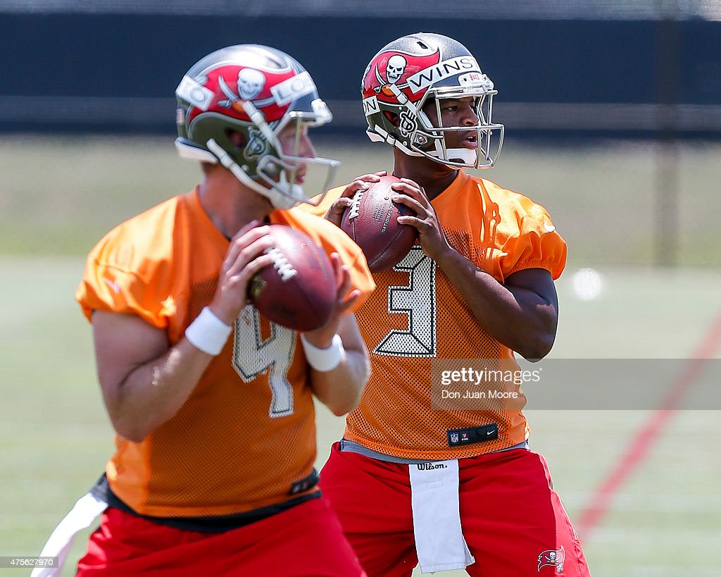 Quarterbacks Jameis Winston #3 and Seth Lobato #4 of the Tampa Bay Buccaneers works out during Rookie Mini Camp at One Buccaneer Place on May 9, 2015 in Tampa, Florida.