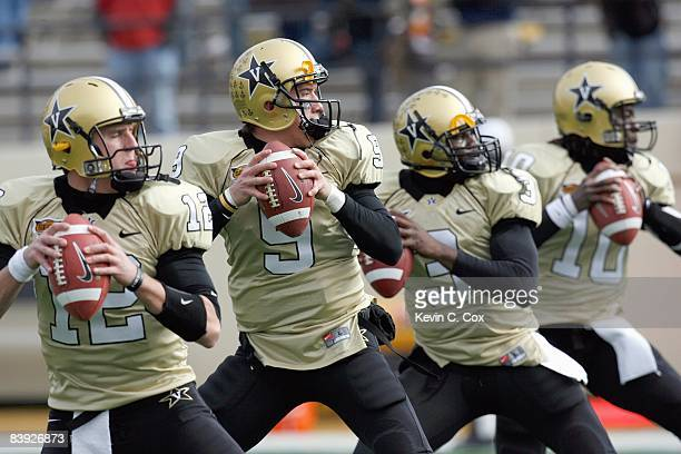 Quarterbacks Jared Funk, Mackenzi Adams, Chris Nickson and Larry Smith of the Vanderbilt Commodores warm up before the game against the Tennessee...