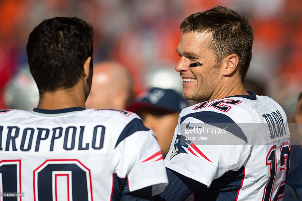 Quarterbacks Jimmy Garoppolo #10 and Tom Brady #12 of the New England Patriots talk on the sidelines during the final minutes of the second half against the Cleveland Browns at FirstEnergy Stadium on October 9, 2016 in Cleveland, Ohio. The Patriots defeated the Browns 33-13.