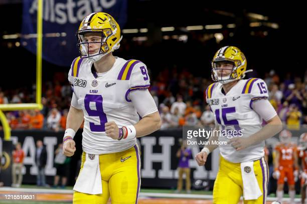 Quarterbacks Joe Burrow and Myles Brennan of the LSU Tigers take to the field before the start of the College Football Playoff National Championship...