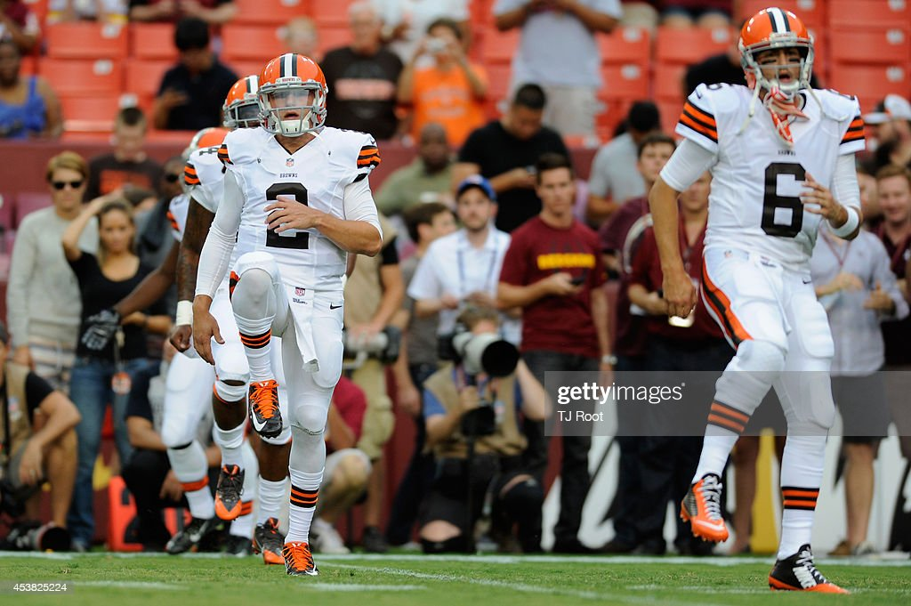 Quarterbacks Johnny Manziel #2 and Brian Hoyer #6 of the Cleveland Browns warm up before the start of a preseason football game against the Washington Redskins at FedExField on August 18, 2014 in Landover, Maryland.