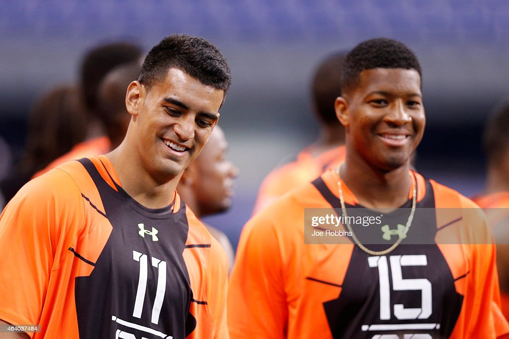 Quarterbacks Marcus Mariota of Oregon and Jameis Winston of Florida State look on during the 2015 NFL Scouting Combine at Lucas Oil Stadium on February 21, 2015 in Indianapolis, Indiana.