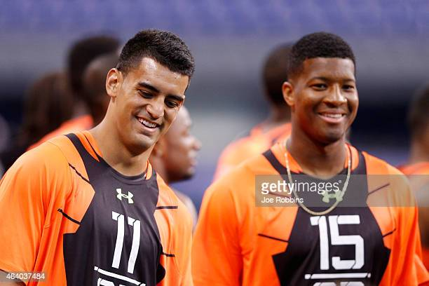 Quarterbacks Marcus Mariota of Oregon and Jameis Winston of Florida State look on during the 2015 NFL Scouting Combine at Lucas Oil Stadium on...