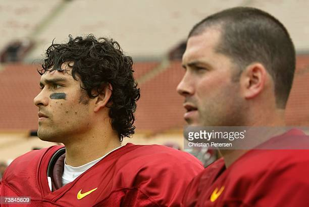 Quarterbacks Mark Sanchez and John David Booty of the USC Trojans look on from the sidelines during a team scrimmage at the Los Angeles Memorial...