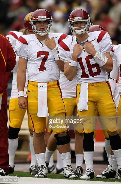 Quarterbacks Matt Barkley and Mitch Mustain of the USC Trojans watch from the sidelines during the game against the Washington Huskies on September...