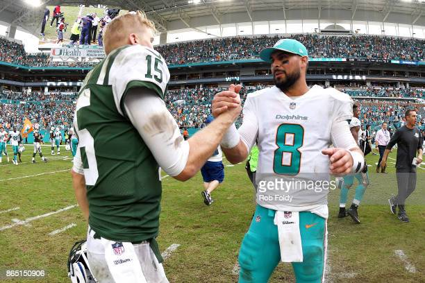 Quarterbacks Matt Moore of the Miami Dolphins and Josh McCown of the New York Jets shake hands after the game at Hard Rock Stadium on October 22 2017...