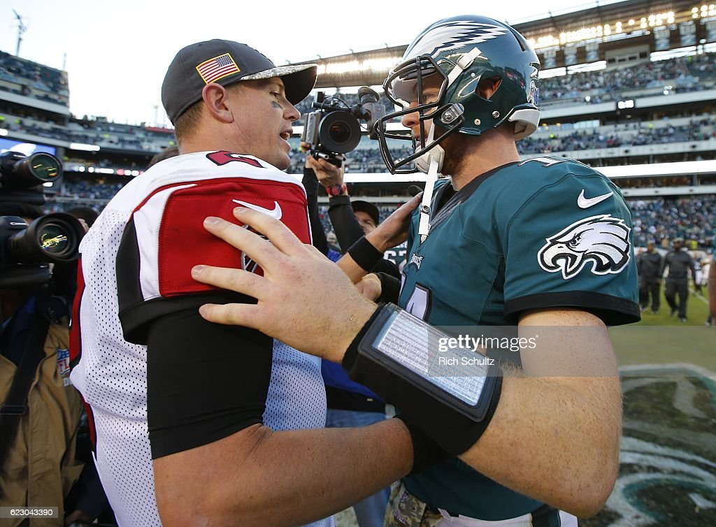 Quarterbacks Matt Ryan #2 of the Atlanta Falcons and Carson Wentz #11 of the Philadelphia Eagles meet after their game at Lincoln Financial Field on November 13, 2016 in Philadelphia, Pennsylvania. The Eagles defeated the Falcons 24-15.