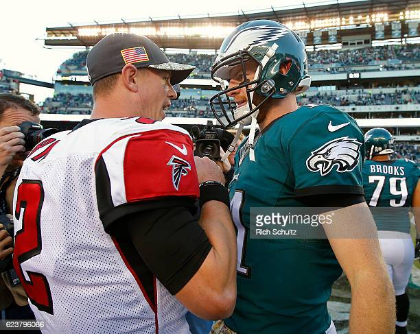 Quarterbacks Matt Ryan of the Atlanta Falcons and Carson Wentz of the Philadelphia Eagles meet after their game at Lincoln Financial Field on...