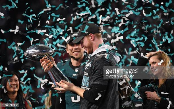 Quarterbacks Nick Foles and Carson Wentz of the Philadelphia Eagles celebrates following victory over the New England Patriots in Super Bowl LII at...
