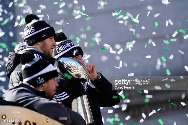 Quarterbacks Nick Foles Nate Sudfeld and Carson Wentz of the Philadelphia Eagles acknowledge fans as Sudfeld hoists the Vince Lombardi Trophy atop a...