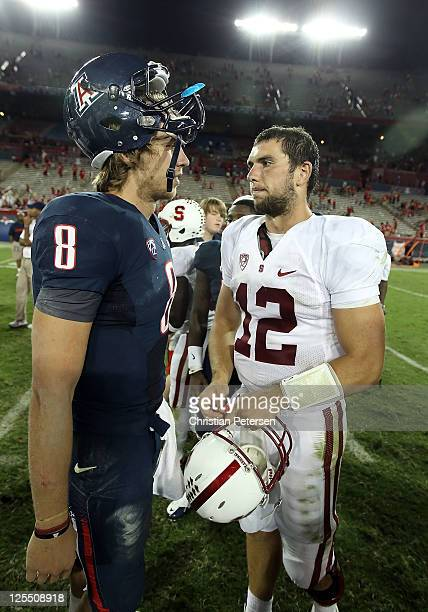 Quarterbacks Nick Foles of the Arizona Wildcats and Andrew Luck of the Stanford Cardinal greet following the college football game at Arizona Stadium...