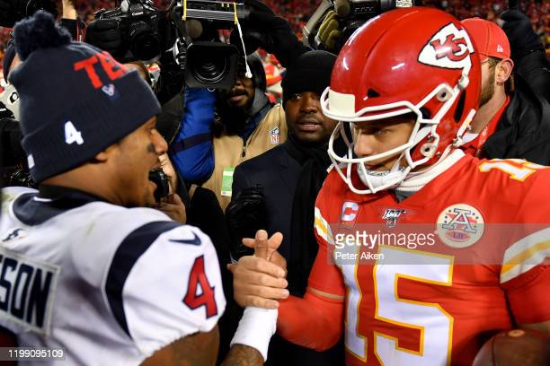 Quarterbacks Patrick Mahomes of the Kansas City Chiefs and Deshaun Watson of the Houston Texans shake hands after Chiefs win the AFC Divisional...