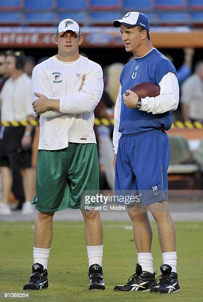 Quarterbacks Peyton Manning of the Indianapolis Colts and Chad Pennington of the Miami Dolphins talk prior to a NFL game against the Miami Dolphins...