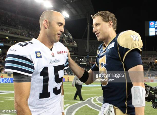 Quarterbacks Ricky Ray of the Toronto Argonauts and Drew Willy of the Winnipeg Blue Bombers meet each other in the field after Winnipeg defeated...