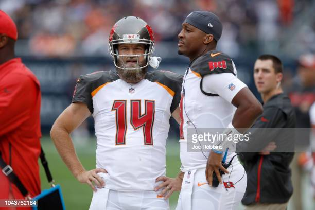 Quarterbacks Ryan Fitzpatrick and Jameis Winston of the Tampa Bay Buccaneers stand on the sidelines in the second quarter against the Chicago Bears...