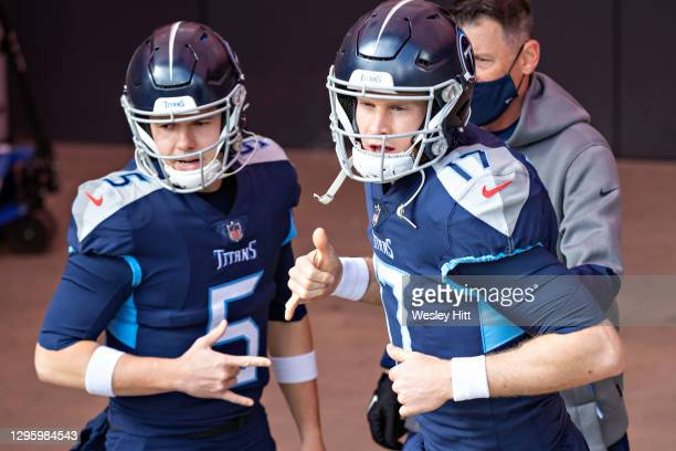 Quarterbacks Ryan Tannehill and Logan Woodside of the Tennessee Titans prepares to run onto the field before their AFC Wild Card Playoff game against...