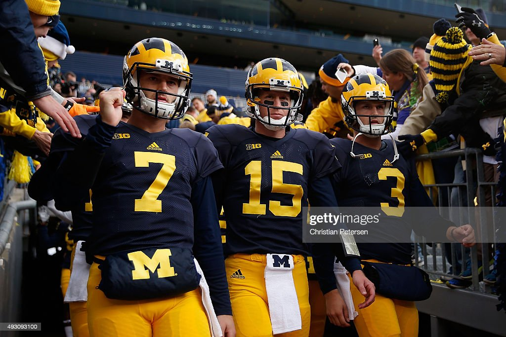 Quarterbacks Shane Morris #7, Jake Rudock #15 and Wilton Speight of the Michigan Wolverines take the field for warm ups to the college football game against the Michigan State Spartans at Michigan Stadium on October 17, 2015 in Ann Arbor, Michigan.