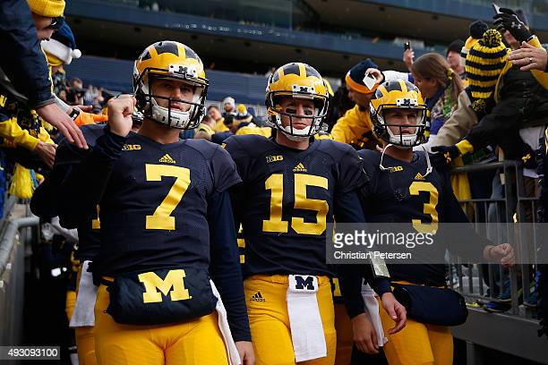 Quarterbacks Shane Morris, Jake Rudock and Wilton Speight of the Michigan Wolverines take the field for warm ups to the college football game against...