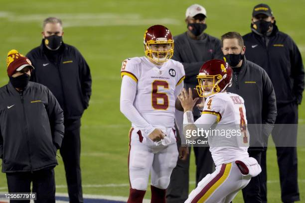 Quarterbacks Steven Montez and Taylor Heinicke of the Washington Football Team warm up before the start of their game against the Tampa Bay...