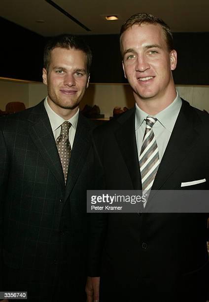 NFL Quarterbacks Tom Brady and Peyton Manning attend the Ermenegildo Zegna Flagship store opening April 13 2004 in New York City